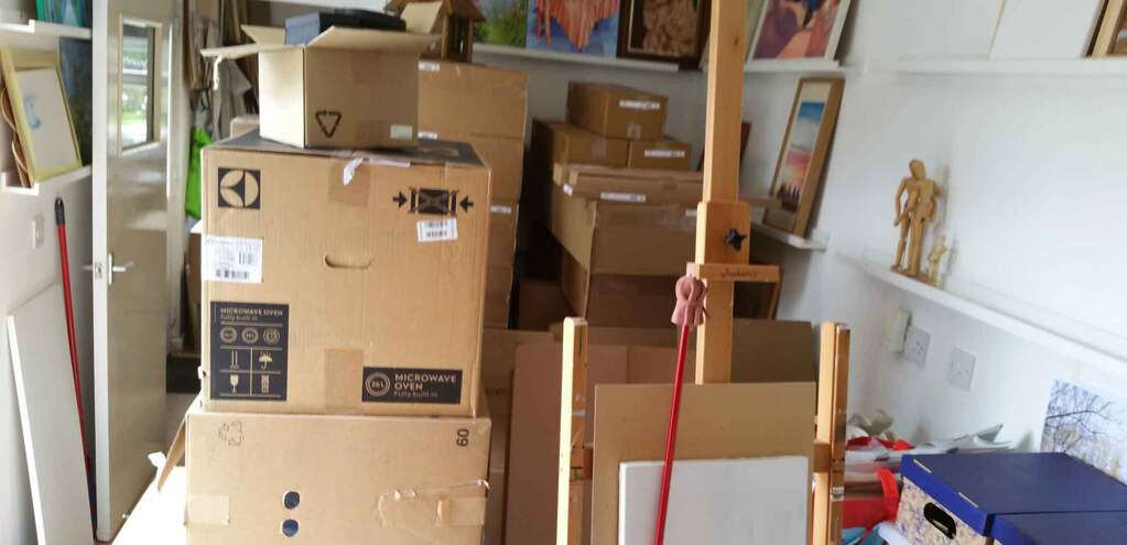 Art studio stuffed with boxes from floor to ceiling