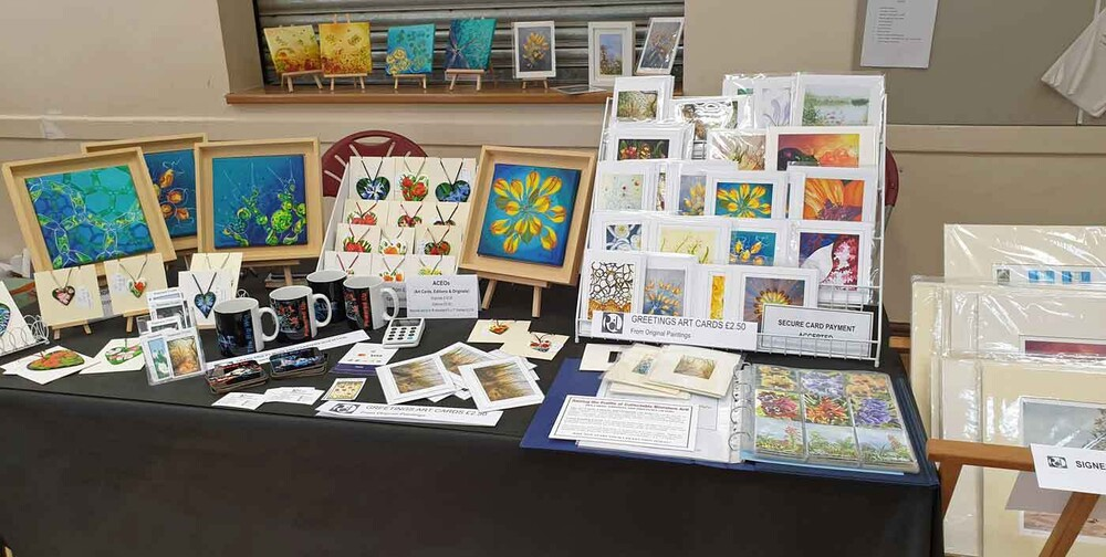 My table laid out with art cards and paintings at nelson craft market